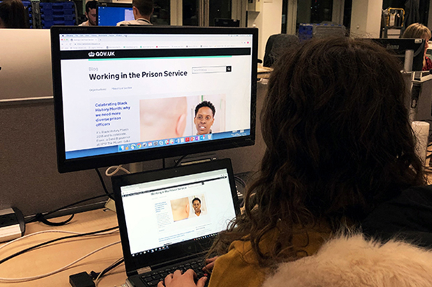 Image of employee looking at the Working in the Prison Service blog on a computer