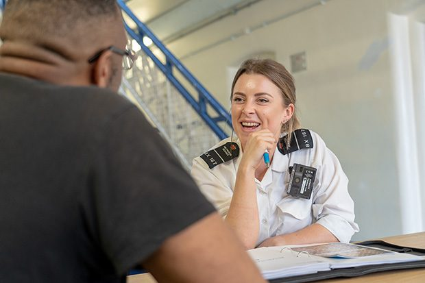 Photograph of a key worker at HMP Brixton talking one-to-one with an offender.