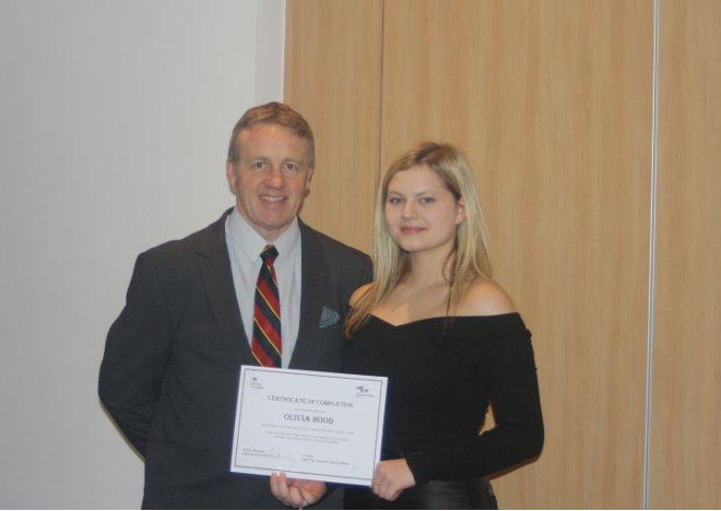 A photograph of Officer Hood and her apprenticeship tutor at the prison officer apprenticeship graduation.