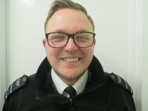 smiling prison officer